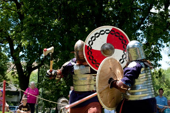 Viking re-enactors battle on the lawns of the Hjemkomst Center for viewers
