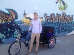 Owner - Zach Johnson and 1 of 2 pedicabs