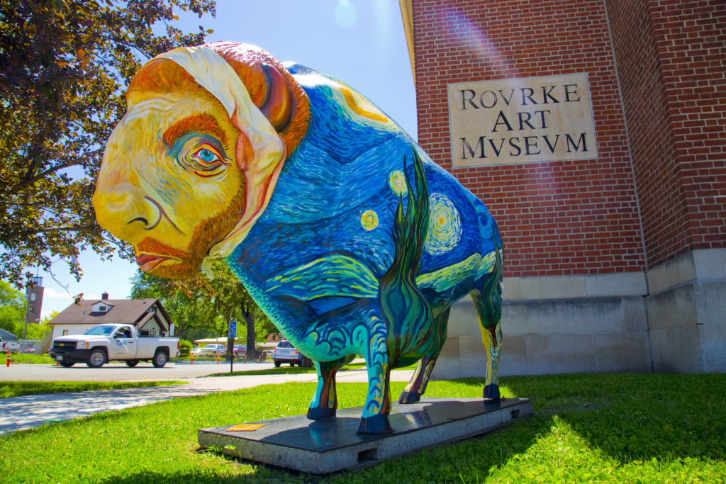Painted bison in front of Rourke Art Museum