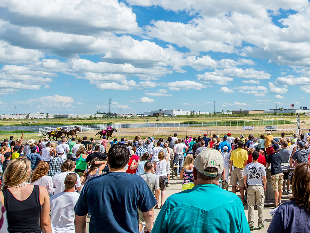 Spectators watching live horse racing at North Dakota Horse Park in Fargo, ND