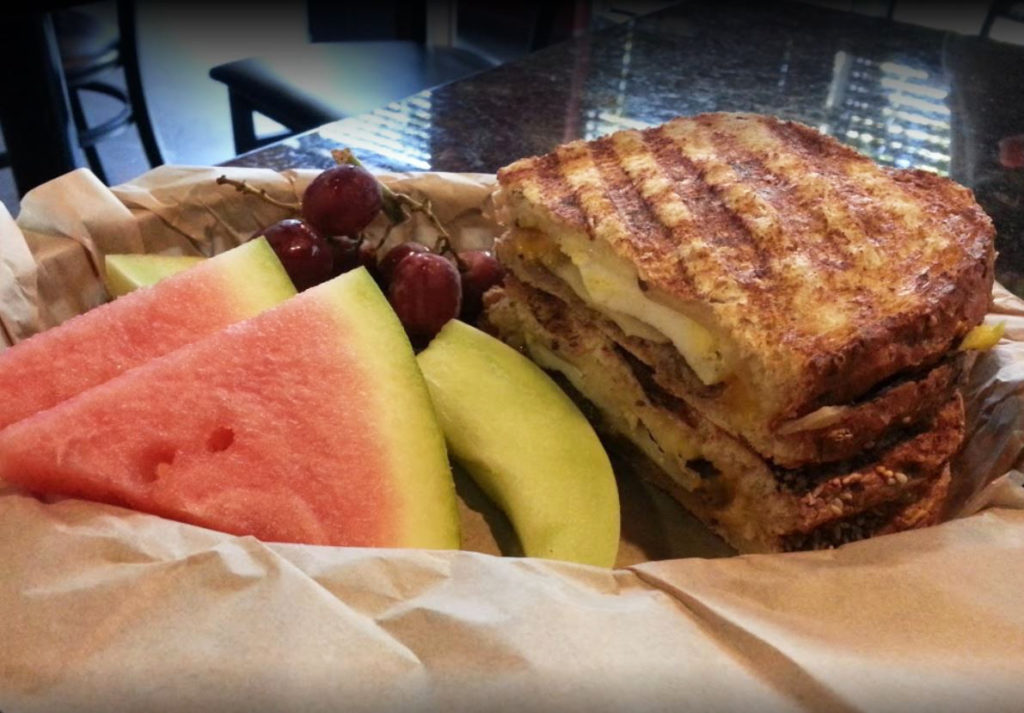 Grilled sandwich and fresh fruit at the Cracked Pepper